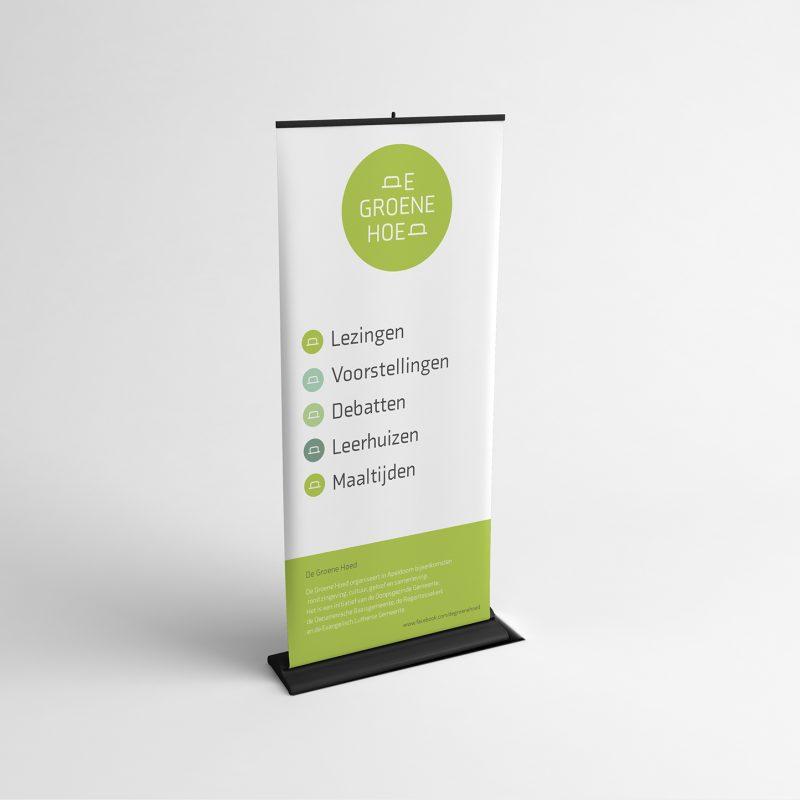 Foto van een banner met het logo De groene hoed